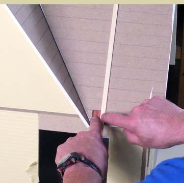 To get the angle for a valley shingle, hold a shingle on the bottom edge of the roof. Hold a piece of 3/8